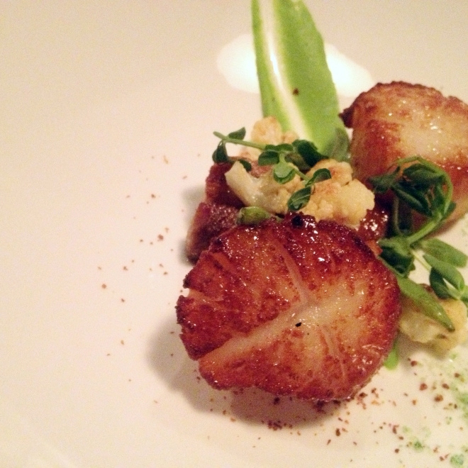 The Pan-seared scallops, green pea puree and wasabi dust appetizer at Big Louis' was delectable- Photo: Kim Gradek